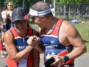 Shahin congratulating Liz, both wearing Fleet Feet Sports tri suits